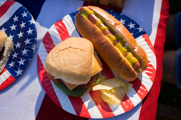 Hot dog, hamburger and crisps served in the plate - Stock Photo - Images
