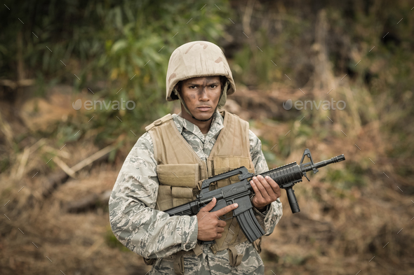 Military soldier guarding with a rifle in a boot camp - Stock Photo - Images