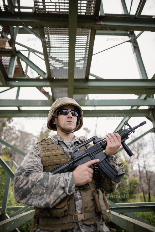 Military soldier guarding with a rifle - Stock Photo - Images
