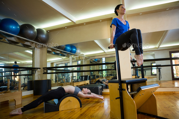 Women exercising in gym - Stock Photo - Images