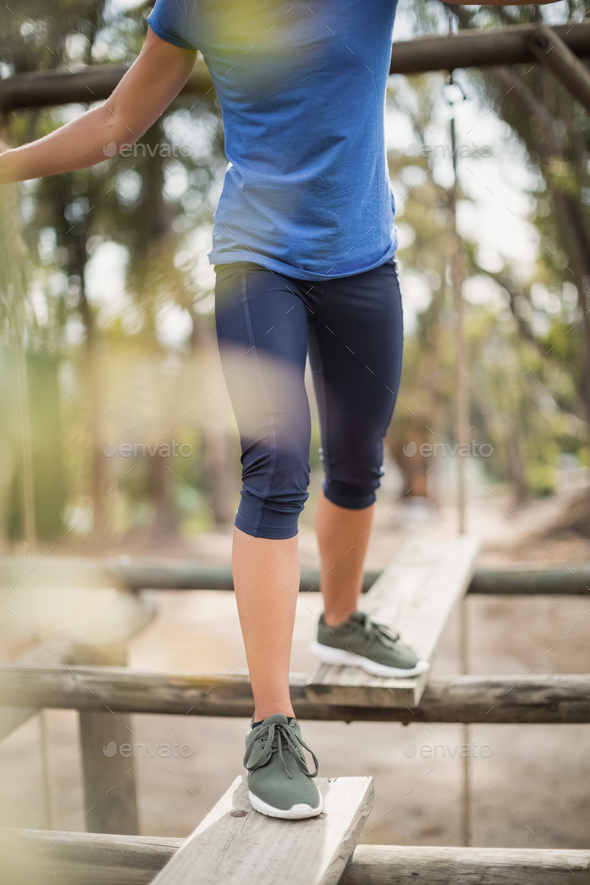 Fit woman during obstacle course training - Stock Photo - Images