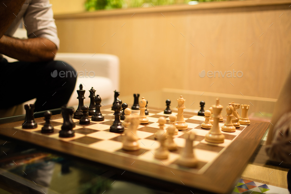 Close up of chess board on glass table - Stock Photo - Images