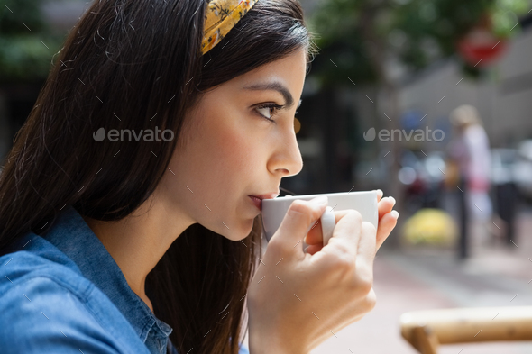 Close up of woman drinking coffee - Stock Photo - Images