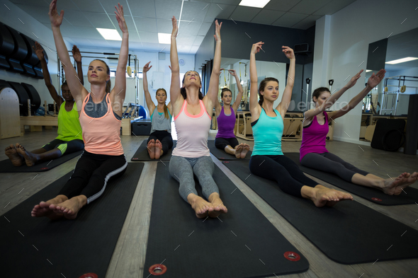 Group of women performing stretching exercise - Stock Photo - Images