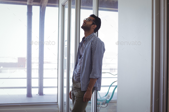 Unhappy businessman in office - Stock Photo - Images