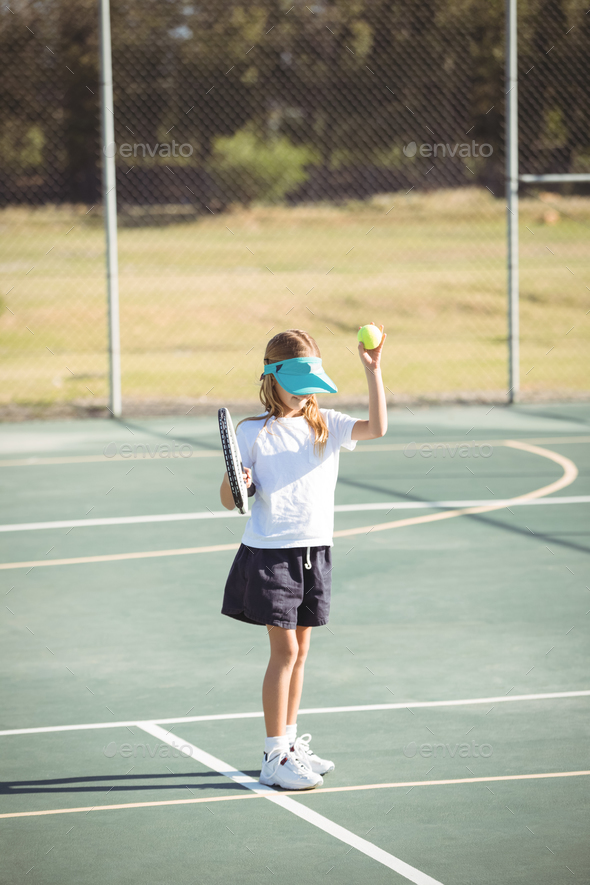 Girl playing tennis at court - Stock Photo - Images