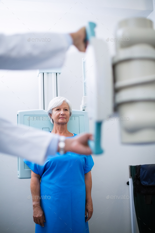 Senior woman undergoing an x-ray test - Stock Photo - Images
