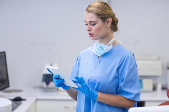 Female nurse using digital tablet - Stock Photo - Images