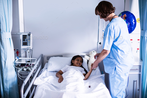 Female doctor checking a sugar level of patient - Stock Photo - Images