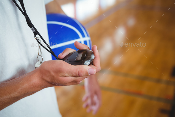 Midsection of basketball coach with stopwatch - Stock Photo - Images