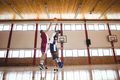 Basketball players playing basketball in the court - PhotoDune Item for Sale