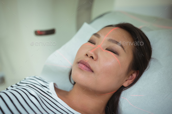 Close-up of patient undergoing CT scan test - Stock Photo - Images