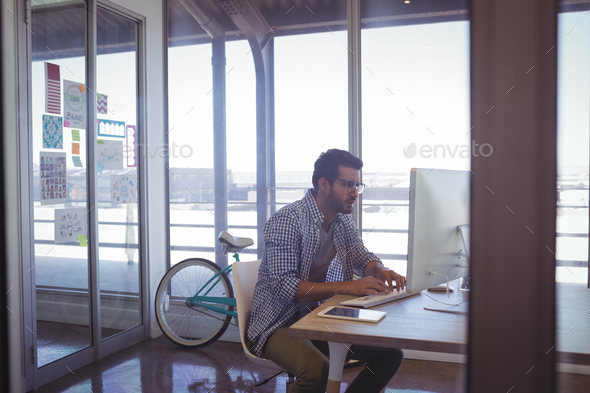 Businessman working on computer in office - Stock Photo - Images
