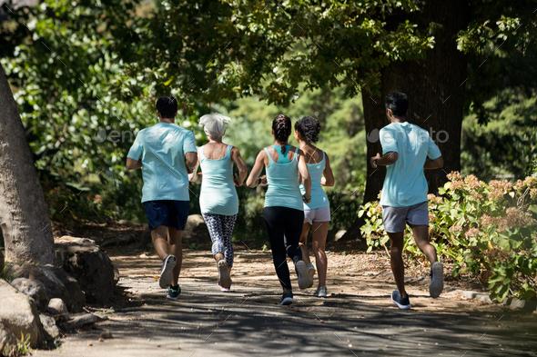 Marathon athletes walking in the park - Stock Photo - Images