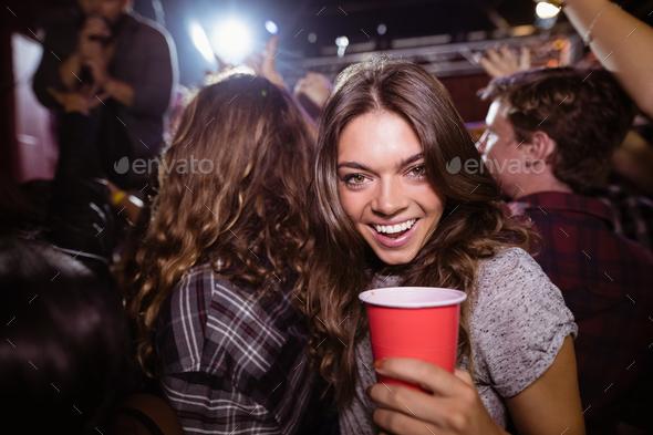 Portrait of happy woman enjoying music festival - Stock Photo - Images