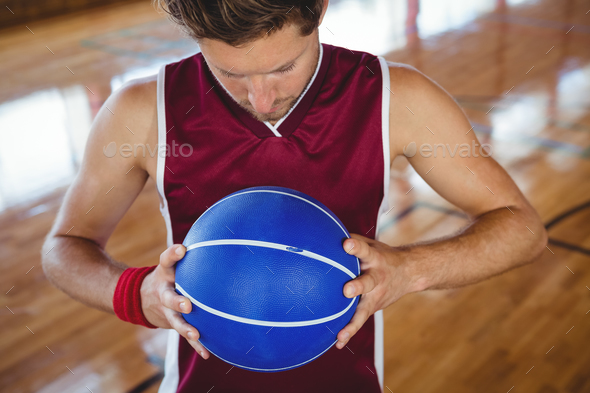 High angle view of male basketball player holding ball - Stock Photo - Images