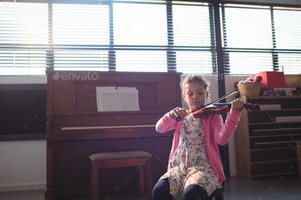 Schoolgirl rehearsing violin - Stock Photo - Images