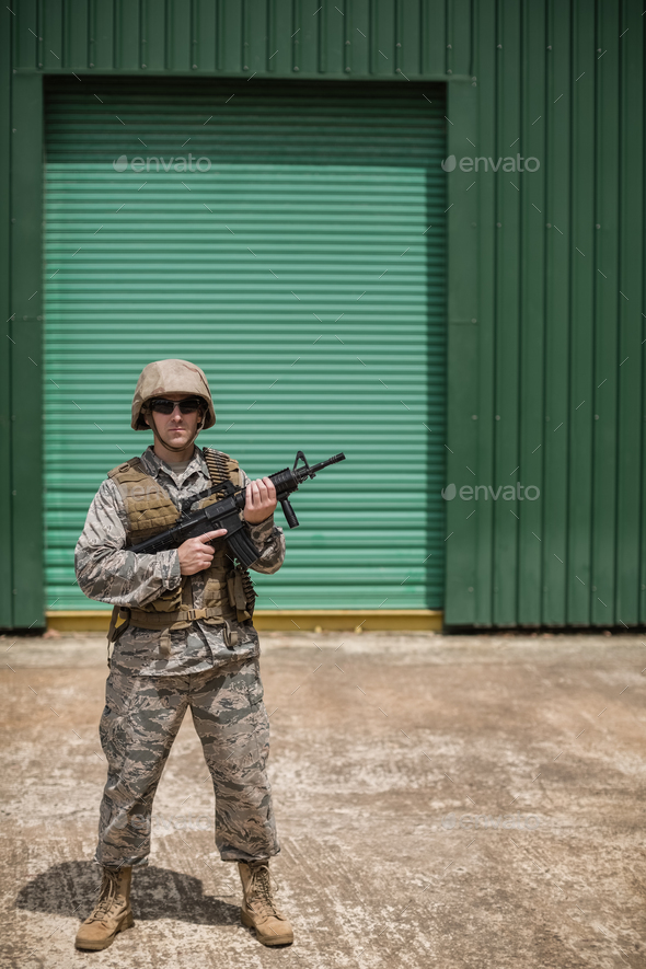 Military soldier standing with a rifle - Stock Photo - Images