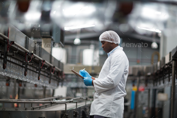 Factory engineer using digital tablet in the factory - Stock Photo - Images
