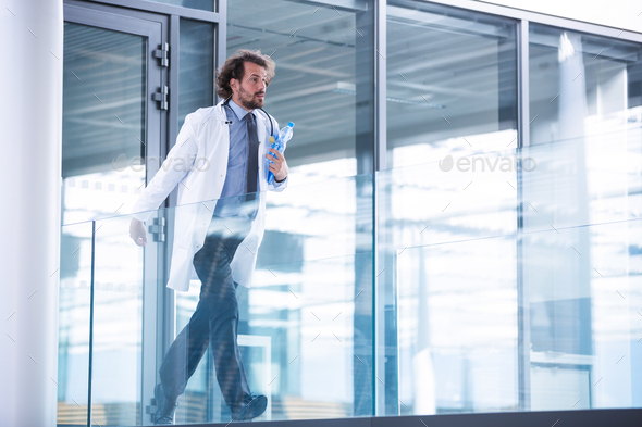 Doctor rushing in corridor - Stock Photo - Images