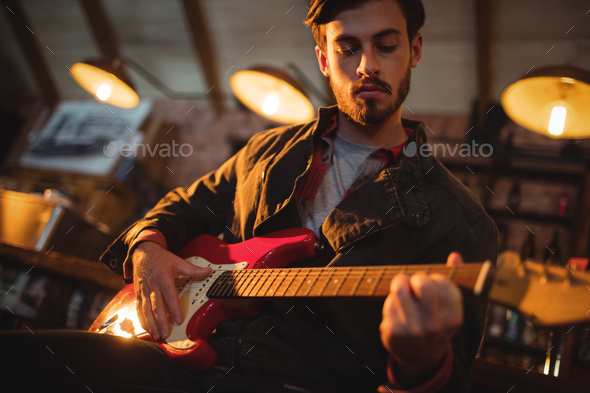 Young man playing guitar - Stock Photo - Images