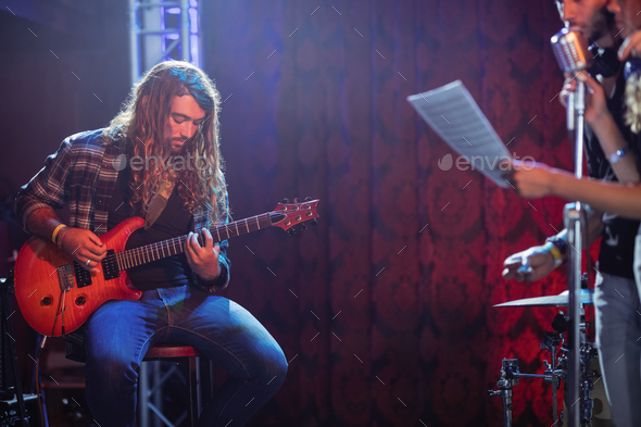 Guitarist and singers performing at nightclub - Stock Photo - Images