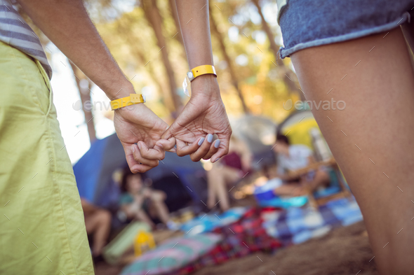 Cropped image of couple hooking pinky fingers - Stock Photo - Images