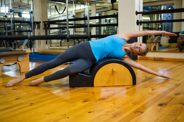Fit woman doing pilates on arc barrel - Stock Photo - Images