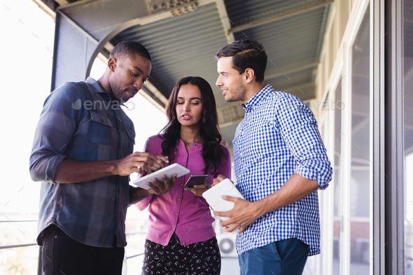 Business people discussing in balcony - Stock Photo - Images