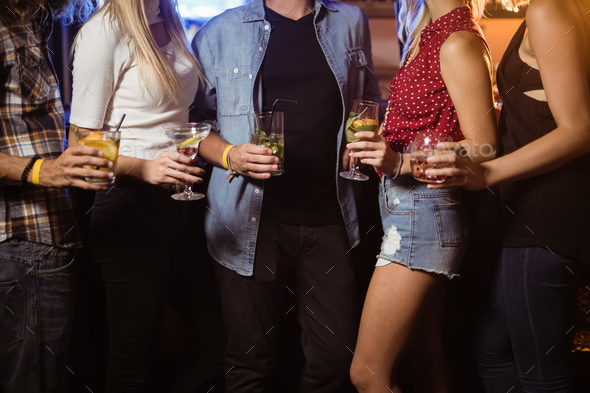 Midsection of friends holding drinks - Stock Photo - Images