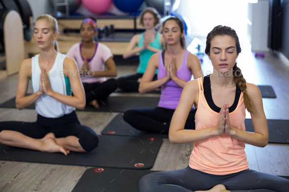 Group of women doing yoga - Stock Photo - Images