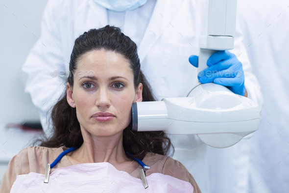 Dentist taking x-ray of patients teeth - Stock Photo - Images