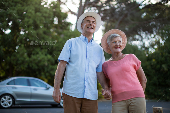 Senior couple standing at roadside - Stock Photo - Images