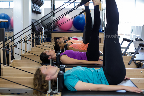 Group of women exercising on reformer - Stock Photo - Images