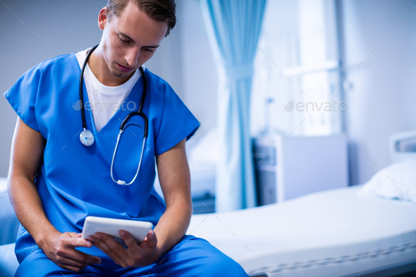 Doctor using digital tablet in ward - Stock Photo - Images