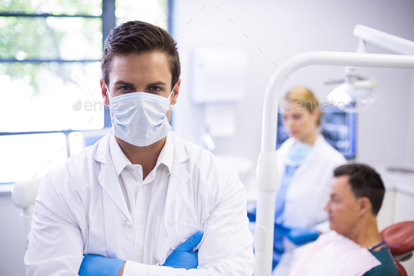 Portrait of dentist wearing surgical mask - Stock Photo - Images