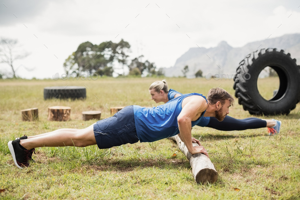 Fit people performing pushup exercise - Stock Photo - Images