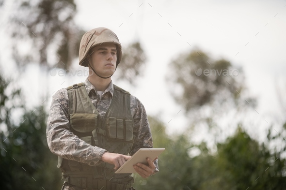 Military soldier using digital tablet - Stock Photo - Images
