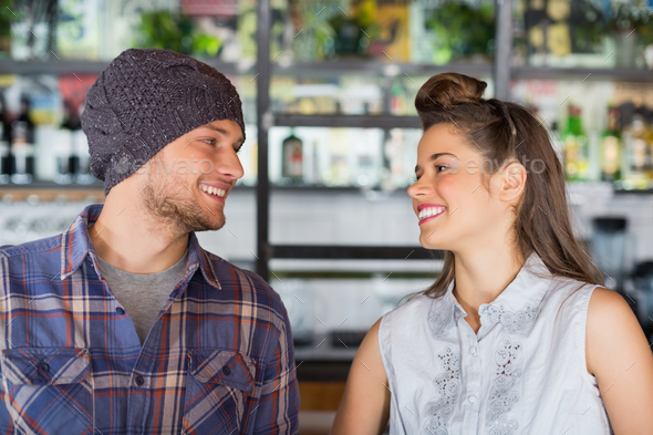 Friends looking at each other in restaurant - Stock Photo - Images
