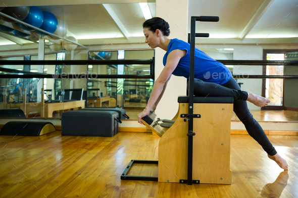 Determined woman exercising on wunda chair - Stock Photo - Images