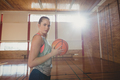 High school girl standing with basketball in the court - PhotoDune Item for Sale