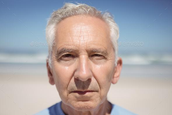 Close up portrait of senior man at beach - Stock Photo - Images