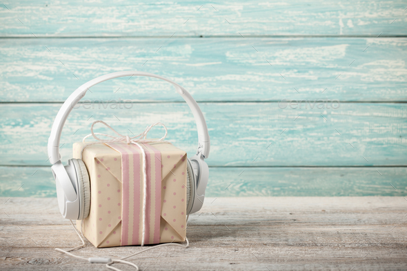 Music concept with gift box and headphones - Stock Photo - Images