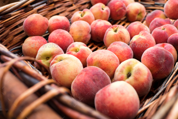 Close up view of basket with fresh juicy peaches - Stock Photo - Images