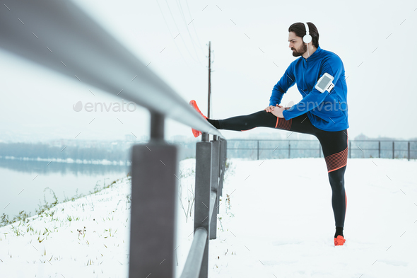 Stretching In Cold - Stock Photo - Images