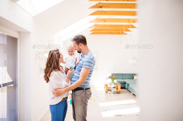 Young family with a baby boy at home, standing. - Stock Photo - Images