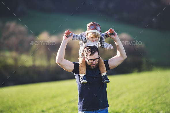 A father with his toddler son outside in spring nature. - Stock Photo - Images
