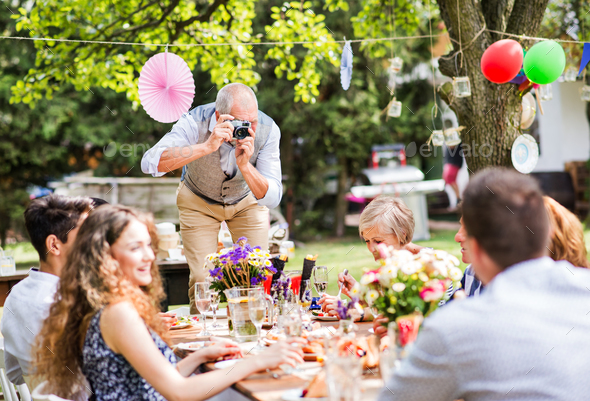 Family celebration or a garden party outside in the backyard. - Stock Photo - Images
