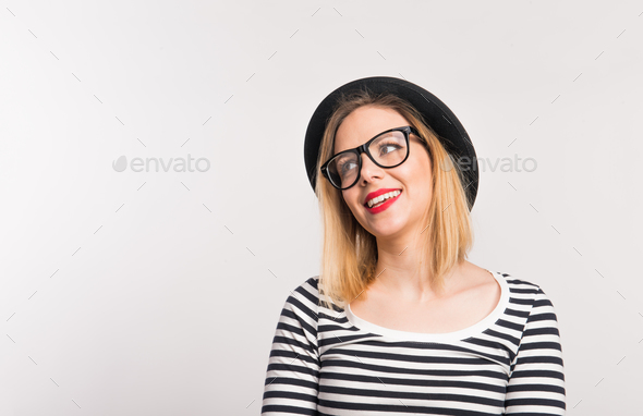 Portrait of a young beautiful woman in studio. Copy space. - Stock Photo - Images