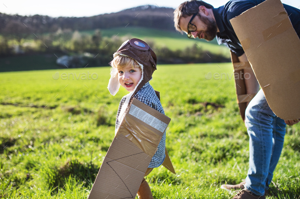 Happy toddler boy playing outside with father in spring nature. - Stock Photo - Images